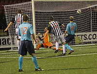 Danny McDonald shoots to score a last minute winner in the St Mirren v Dunfermline Athletic Scottish Professional Football League Under 20 match played at the Excelsior Stadium, Airdrie on 11.12.13.