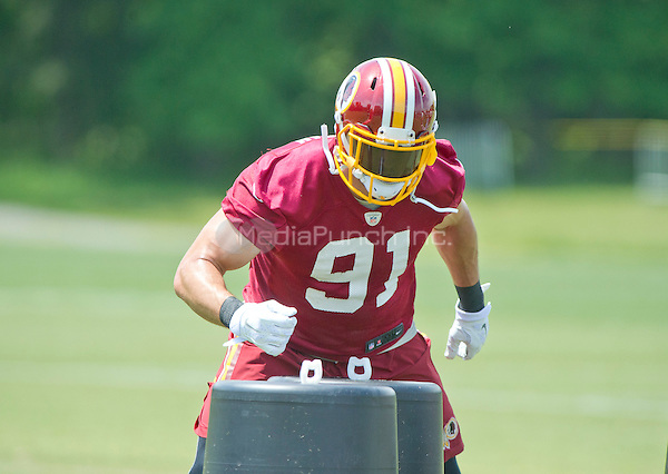 Washington Redskins linebacker Ryan Kerrigan (91) participates in an organized team activity (OTA) at Redskins Park in Ashburn, Virginia on Wednesday, May 25, 2015.<br /> Credit: Ron Sachs / CNP/MediaPunch ***FOR EDITORIAL USE ONLY***
