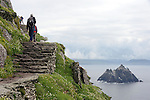 SKELLIGS ROCKS IRELAND:Tourists make their way up the 600 steps to the top of Skellig Micheal where filming of Star Wars is due to take place in September.<br /> Photo: Don MacMonagle