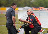 Apr 14, 2019; Baytown, TX, USA; NHRA Vice President-Racing Administration Josh Peterson (left) talks with pro mod driver Rickie Smith during the Springnationals at Houston Raceway Park. Mandatory Credit: Mark J. Rebilas-USA TODAY Sports