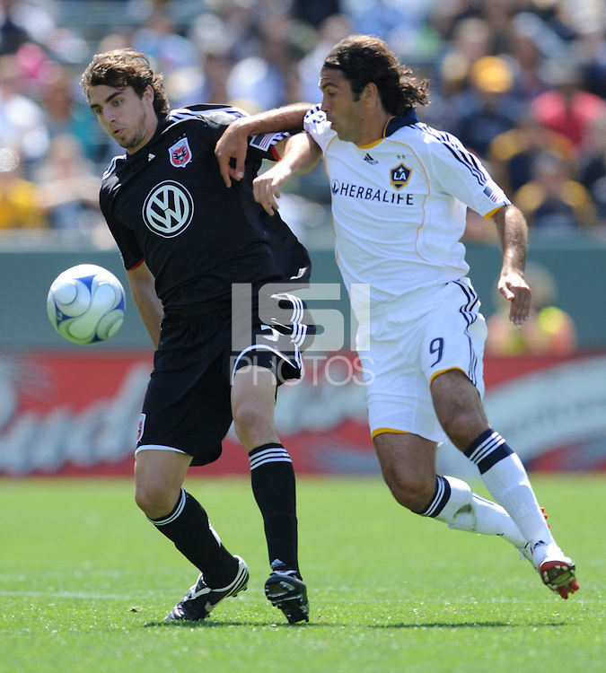 Los Angeles Galaxy's Jovan Kirovski (9) battles D.C. United's Dejan (left) Jakovic at the Home Depot Center in Carson, CA on Sunday, March 22, 2009.