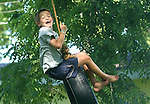 Colby Powers, 8, swings on his tire swing in his Sauk City, Wisconsin backyard.  It's one of his favorite summer things to do when he's not playing with his two brothers.