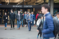 People walk out of the Science Center at Harvard University in Cambridge, Massachusetts, USA, on Mon., Oct 15, 2018.