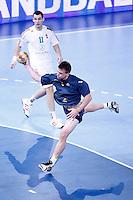 Australia's Callum Mouncey (r) and Hungary's Barna Putics during 23rd Men's Handball World Championship preliminary round match.January 14,2013. (ALTERPHOTOS/Acero) /NortePhoto