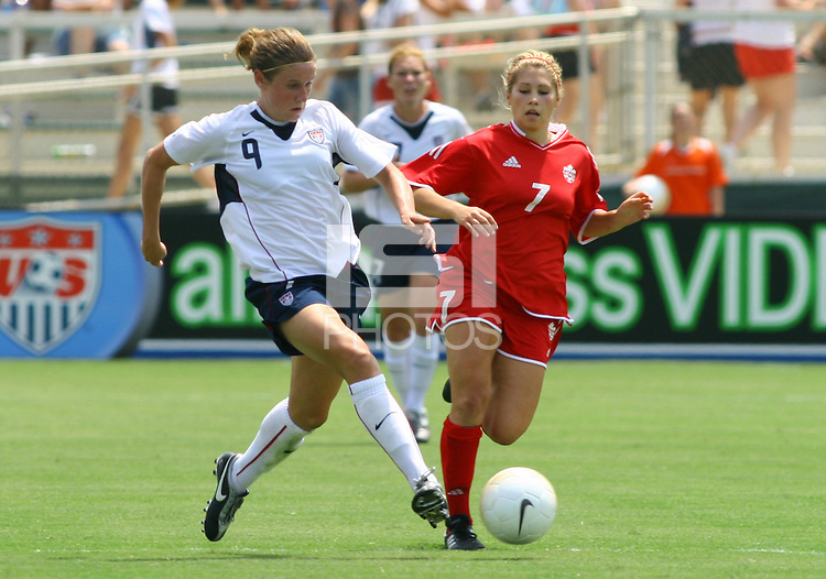 Heather O'Reilly tries to tackle the ball away from Canada's Amanda Cicchini. The USA defeated Canada 2-0 at SAS Stadium in Cary, NC on Sunday, July 30, 2006.