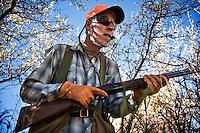 David Thompson, of Bozeman, Montana, hunts pheasant through thick cover near the Missouri River Breaks.