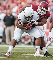 STAFF PHOTO ANTHONY REYES • @NWATONYR<br /> Arkansas Trey Flowers tackles Northern Illinois University tailback Joel Bouagnon in the first quarter Saturday, Sept. 20, 2014 at Razorback Stadium in Fayetteville.