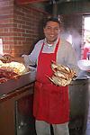 Crab vendor at sidewalk cafe along Fisherman's Wharf, San Francisco, California