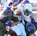 SIOUX FALLS, SD - SEPTEMBER 6: Marco Naughton #94 from the University of Sioux Falls leads a host of defenders to bring down Jarvis Mustipher #24 from Minot State in the first quarter of their game Saturday afternoon at Bob Young Field in Sioux Falls.  (Photo by Dave Eggen/Inertia)