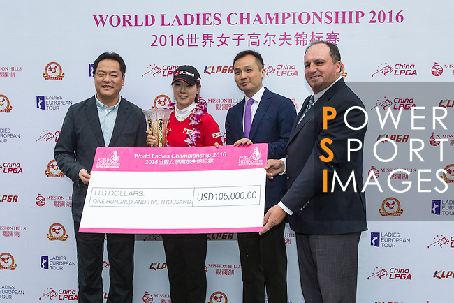 Jung Min Lee of South Korea (second from left) receives her trophy and check from the hands of Wang Liwei (left), T.K. Pen (second from right), and Iain Roberts (right) during the Prize giving ceremony of the World Ladies Championship 2016 on 13 March 2016 at Mission Hills Olazabal Golf Course in Dongguan, China. Photo by Victor Fraile / Power Sport Images
