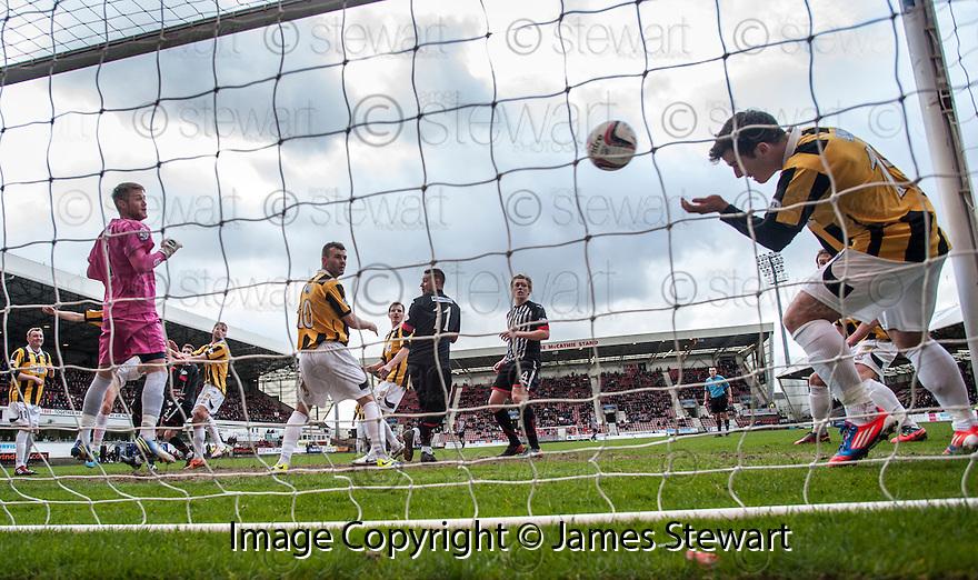 East Fife's Liam Buchanan heads Pars' Andrew Geggan's header off the line.