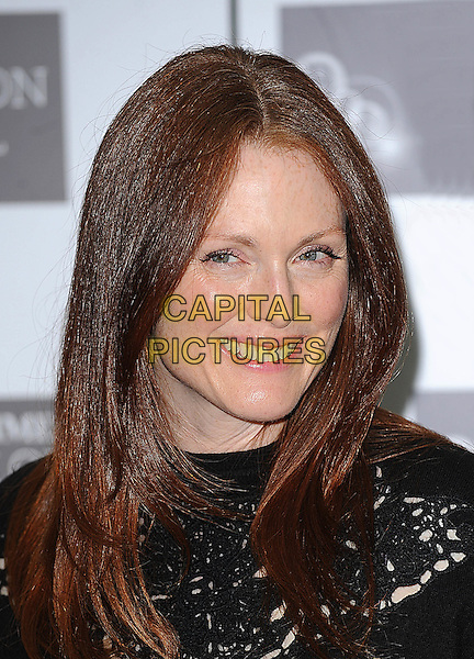 "JULIANNE MOORE.Photocall for ""Chloe"" during The Times BFI London Film Festival at Mayfair Hotel, London, England. .October 22nd, 2009 .LFF headshot portrait black crochet cut out away smiling.CAP/BEL.©Tom Belcher/Capital Pictures."