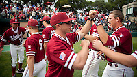 STANFORD, CA - April 23, 2011: Assistant Brock Ungricht of Stanford baseball congratulates Stephen Piscotty after Stanford's game against UCLA at Sunken Diamond. Stanford won 5-4.