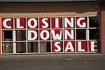 Closing down sale sign in shop window