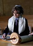Bar Mitzvah boy reading the Torah on the beema.  CSI synagogue, Briarcliff Manor, New York.