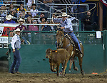 Joey Dickens competes in the Tie Down Roping event during the Reno Rodeo on Sunday, June 23, 2019.