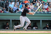 Outfielder Carl Thomore (13) of the Kannapolis Intimidators bats in a game against the Greenville Drive on Friday, April 11, 2014, at Fluor Field at the West End in Greenville, South Carolina. Greenville won, 13-2. (Tom Priddy/Four Seam Images)