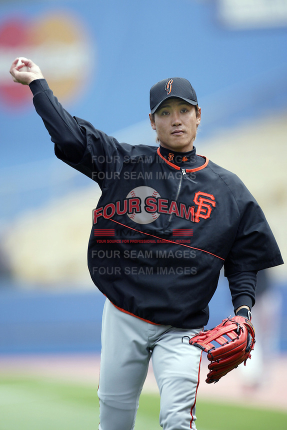 Tsuyoshi Shinjo of the San Francisco Giants throws before a 2002 MLB season game against the Los Angeles Dodgers at Dodger Stadium, in Los Angeles, California. (Larry Goren/Four Seam Images)