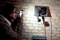 Roma, 24 Marzo 2016.<br /> foto all'antico telefono con uno smartphone<br /> Apre al pubblico il bunker dei Savoia.<br /> Il rifugio antiaereo dei Savoia fu costruito nel parco di Villa Ada nel 1940-42. Di forma circolare e a circa 200 m. di profondità, era accessibile alle auto e dotato di un efficace sistema di impianto di aerazione e filtraggio, azionabile anche in assenza di energia elettrica.<br /> <br /> Rome, March 24, 2016 .<br /> Opening to the public the Savoy bunker.<br /> The air-raid shelter of the Savoy was built in the park of Villa Ada in 1940-42 . Circular in shape and about 200 m . depth , was accessible to cars and equipped with an effective ventilation system and filtering system , also operable in the absence of electricity .