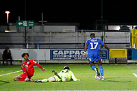 Michael Folivi of AFC Wimbledon rounds the keeper during the The Leasing.com Trophy match between AFC Wimbledon and Leyton Orient at the Cherry Red Records Stadium, Kingston, England on 8 October 2019. Photo by Carlton Myrie / PRiME Media Images.