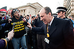 Liberal Democrat and London Mayoral Hopeful Patrick Streeter tries to speak with demonstrators, on Friday afternoon, outside Sheffield City Hall where the Liberal Democrat Conference is being held.11 March 2011.Images © Paul David Drabble