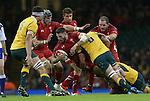 Australian flanker Sean McMahon tackles Wales wing Alex Cuthbert<br /> Dove Men Series 2014<br /> Wales v Australia<br /> Millennium Stadium<br /> 08.11.14<br /> ©Steve Pope-SPORTINGWALES