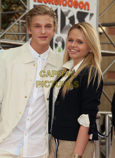 Cody Simpson, Alli Simpson.2012 Nickelodeon Kids' Choice Awards held at the Galen Center, Los Angeles, California, USA..March 31st, 2012.half length white shirt cream jacket black .CAP/ADM/RE.©Russ Elliot/AdMedia/Capital Pictures.