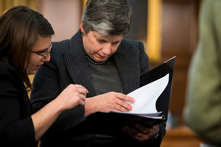 WASHINGTON, DC - March 02: Homeland Security Secretary Janet Napolitano, right, goes over notes with an aide as they wait for the start of the House Appropriations Subcommittee on Homeland Security hearing on the administrations' fiscal 2012 budget request. The House was conducting a series of votes, which delayed committee members' arrival. (Photo by Scott J. Ferrell/Congressional Quarterly)