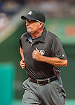 15 June 2016: MLB Umpire Dale Scott works 3rd base during a game between the Chicago Cubs and the Washington Nationals at Nationals Park in Washington, DC. The Cubs fell to the Nationals 5-4 in 12 innings, giving up the rubber match of their 3-game series. Mandatory Credit: Ed Wolfstein Photo *** RAW (NEF) Image File Available ***