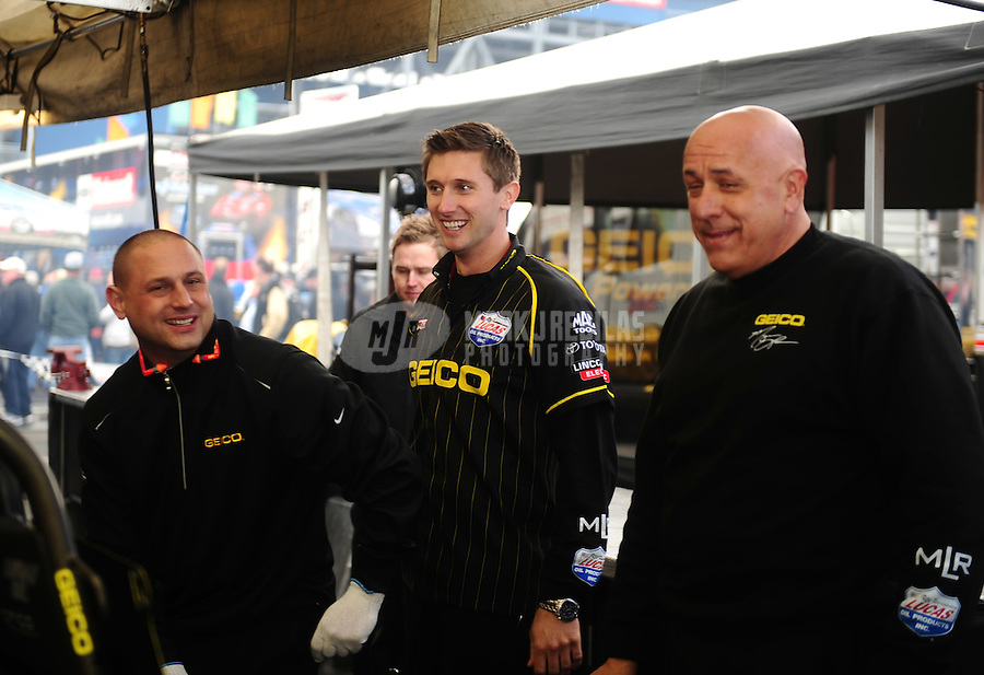 Feb. 26, 2011; Pomona, CA, USA; NHRA top fuel dragster driver Morgan Lucas (center) with crew members during qualifying at the Winternationals at Auto Club Raceway at Pomona. Mandatory Credit: Mark J. Rebilas-.
