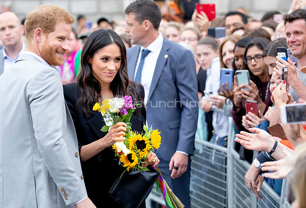 Prince Harry and Meghan, The Duke and Duchess of Sussex at the Trinity College in Dublin, on July 11, 2018, to meet members of the public at Trinity College's Parliament Square, on the last of a 2 days visit to Dublin<br /> Photo : Albert Nieboer/DPA/MediaPunch ***FOR USA ONLY***