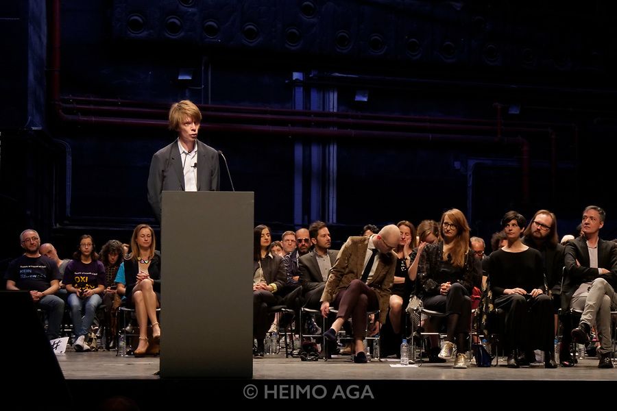 Athens, Greece. Opening days of documenta14. Opening Press Conference at  Megaron Mousikis (Concert Hall). <br /> Chief Curator Adam Szymczyk holding his speech in front of participating artists, curators and other members of the documenta 14 team sitting on the stage, facing the press.