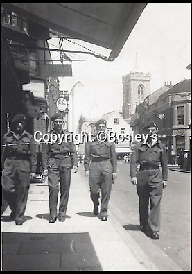 BNPS.co.uk (01202 558833)<br /> Pic :   Bosley's/BNPS<br /> <br /> Douglas Protheroe (far left).<br /> <br /> Top secret maps and documents belonging to a hero medic who served on D-Day have been unearthed 75 years later.<br /> <br /> Douglas Protheroe helped set up a field hospital at the cafe next to Pegasus Bridge in Normandy in the aftermath of the famous British assault there just after midnight on June 6, 1944.<br /> <br /> The team of medics removed wounded men from the bridge over the Caen Canal, coming under enemy fire while doing so.<br /> <br /> The maps showing Protheroe's drop zone are being sold by Bosley's Auctioneers.