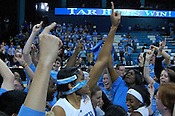 Tar Heel Senior Martina Wood celebrates after the UNC students rushed the court. (Photo by Rob Rowe)