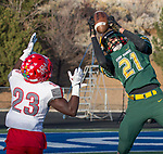 Bishop Manogue Miners Dontell Jackson (21) jumps in front of Arbor View Aggies  Darius Harrison (23) in the fourth quarter of their NIAA 4A State Semi-Final football game played at McQueen High School on Saturday, Nov. 24,2018.