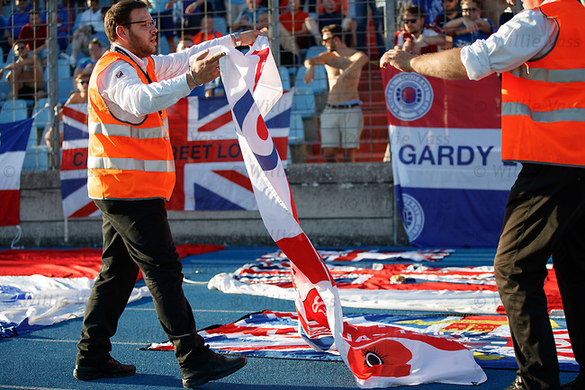 Stewards helping to lay out flags during the match