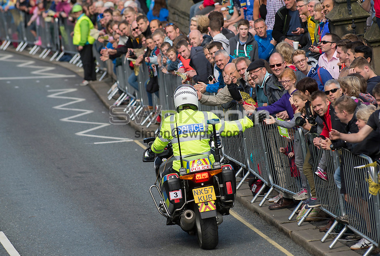 Picture by Allan McKenzie/SWpix.com -  05/07/2014 - Cycling - Tour de France 2014 Grand Depart - Stage 1, Leeds to Harrogate - Yorkshire, England - Police motor cyclists interact with the crowd.