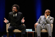 January 12, 2012  (Washington, DC)  Radio and television talk show host Tavis Smiley (right) listens as Dr. Cornell West speaks during a moderated discussion on restoring America's prosperity at the George Washington University Lisner Auditorium in Washington.  (Photo by Don Baxter/Media Images International)