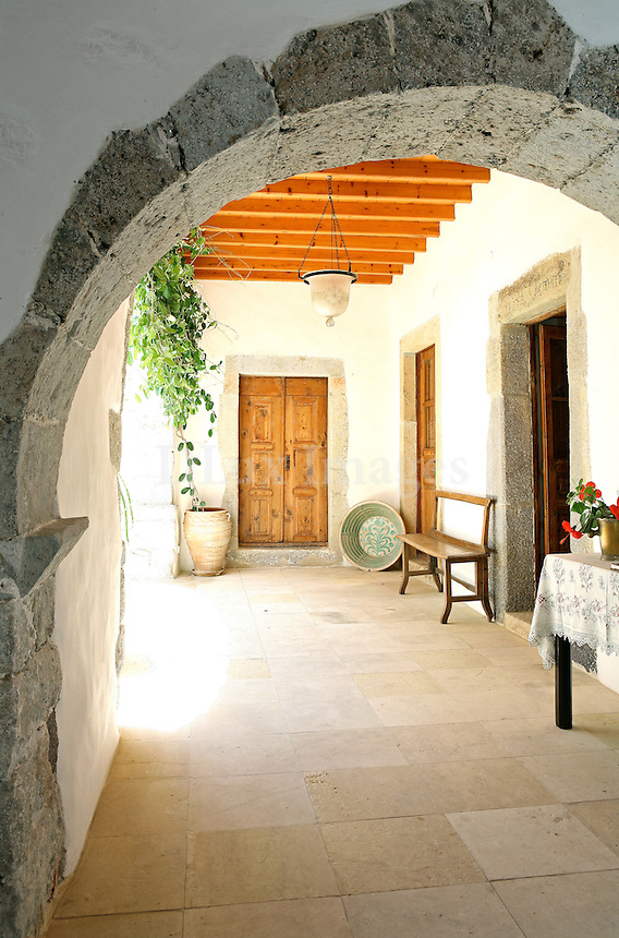 In a charming corner of the Town of Patmos island, called Malandraki, a unique residence, with great history, towers majestically.