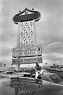 March 1969. Las Vegas, Nevada, USA. French singer and actress Line Renaud lying on a car under a billboard at the Dunes Casino in Las Vegas in 1969. Renaud was one of France most-loved, respected, and successful entertainers.