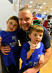 JOHN JOYCE and his sons (L to R) JOHNNY JOYCE, 6, and LIAM JOYCE, 3, participated at St. Baldrick's head shaving event at Calhoun High School. The  Long Island exceeds its goal of raising $50,000 for childhood cancer research. Plus, many ponytails cut off will be donated to Locks of Love foundation, which collects hair donations to make wigs for children who lost their hair due to medical reasons.