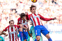 Diego Godin, Stefan Savic, and Antoine Griezmann of Atletico de Madrid competes for the ball during the match of Spanish La Liga between Atletico de Madrid and Futbol Club Barcelona at Vicente Calderon Stadium in Madrid, Spain. February 26, 2017. (ALTERPHOTOS) /NortEPhoto.com
