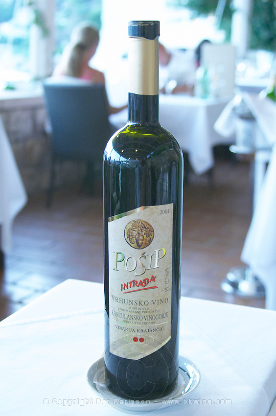 A bottle of 2004 Posip Intrada Vrhunsko vino wine from Korculansko Vinogorje Vinarija Krajancic winery on the Korcula island. from the luxury Excelsior Hotel and Spa restaurant terrace Dubrovnik, old city. Dalmatian Coast, Croatia, Europe.