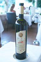 A bottle of 2004 Posip Intrada Vrhunsko vino wine from Korculansko Vinogorje Vinarija Krajancic winery on the Korcula island. from the luxury Excelsior Hotel and Spa restaurant terrace Dubrovnik, old city. Dalmatian Coast, Croatia, Europe.