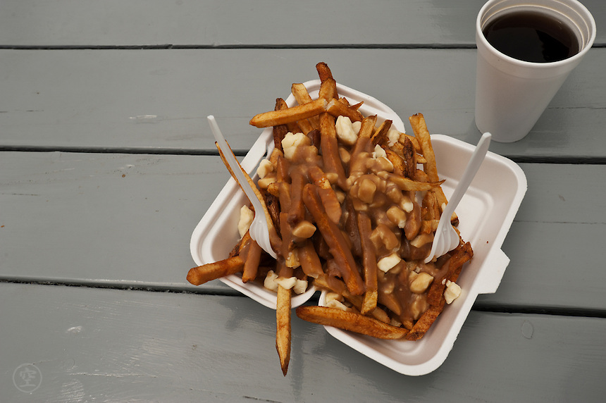 Lunch in Wawa: Poutine and coffee to share with a friend.