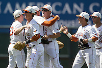 Texas Longhorns teammates celebrate after winning the NCAA Super Regional baseball game against the Houston Cougars on June 7, 2014 at UFCU Disch–Falk Field in Austin, Texas. The Longhorns are headed to the College World Series after they defeated the Cougars 4-0 in Game 2 of the NCAA Super Regional. (Andrew Woolley/Four Seam Images)