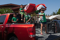 Los Angeles, CA -  Monday, June 23, 2014: Some young Mexico fans in Lynwood, CA cheer outside their home after Mexico defeated Croatia.