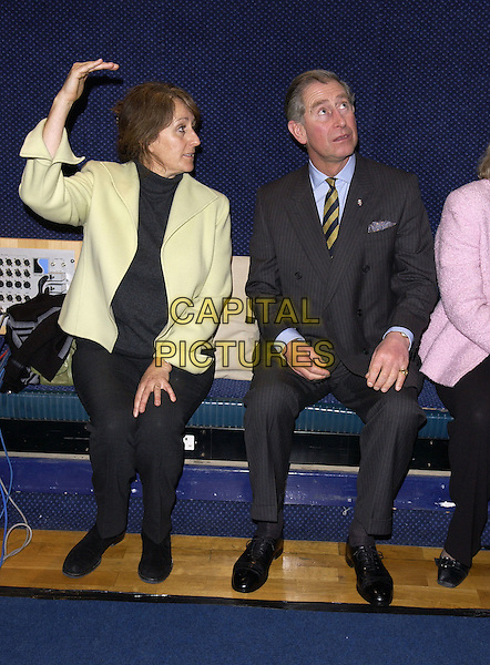 HRH PRINCE CHARLES .At The Prince's Trust Young Urban Music Talent Workshop, Trevor Horn's Sarm West Studios, London, .February 17th 2005..full length sitting Prince of Wales looking up funny royal.Ref: FIN.www.capitalpictures.com.sales@capitalpictures.com.©Steve Finn/Prince's Trust/Capital Pictures.