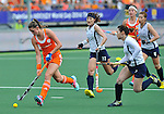 The Hague, Netherlands, June 09: Lidewij Welten #12 of The Netherlands runs with the ball during the field hockey group match (Women - Group A) between The Netherlands and Korea on June 9, 2014 during the World Cup 2014 at Kyocera Stadium in The Hague, Netherlands. Final score 3-0 (1-0)  (Photo by Dirk Markgraf / www.265-images.com) *** Local caption *** Lidewij Welten #12 of The Netherlands, Jongeun Kim #11 of Korea, Sena Cha #7 of Korea, Youngran Kim #4 of Korea