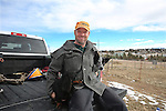 "Laramie County native Stuart Flynn poses with his dogs Winston, left, and Bailey, right, in the back off his truck at his home in northern Cheyenne Friday afternoon. Flynn said he loves the area because it affords many opportunities for outdoor recreation.  To participate in WTE Photo Editor Michael Smith's 2014 ""Our Faces: Portraits of Laramie County"" project, call him at 633-3124 or 630-8388 or email msmith@wyomingnews.com. Michael Smith/staff"